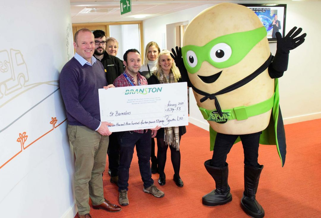 Branston presents fundraising cheque to St Barnabas